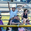 CARL RUSSO/Staff photo Paul and Regina DeBenedictis (top) cheer for their son Ryan and his team the Andover American in Little League action against North Andover.  <br /> <br /> North Andover defeated Andover American 9-8 in Little League baseball action at the Carl Thomas field in North Andover Friday night.  6/28/2019