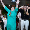 CARL RUSSO/Staff photo Doloris Puopolo of Boston celebrates winning a game of heads or tails played during the St. Joseph Regional Catholic School's Havana Nights fundraising gala. <br /> <br /> St. Joseph Regional Catholic School in Salem N.H. held their 2019 Annual Fundraising Gala called Havana Nights. All proceeds from the gala go directly to St. Joseph Regional Catholic School's operating budget so that the school may continue to offer an outstanding catholic education to their students. 3/23/2019