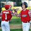 CARL RUSSO/Staff photo  North Andover's Dylan Lawrence and Gabe Polonsky exchange greetings coming off the field. <br /> <br /> North Andover defeated Andover American 9-8 in Little League baseball action at the Carl Thomas field in North Andover Friday night.  6/28/2019