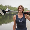 AMANDA SABGA/Staff photo<br /> <br /> Lisa Doucett, of Andover, a multi sport athlete poses at the Greater Lawrence Community Boating where she rows. Doucett has run 25 Boston Marathons and competed in hundred of races including running, rowing and skiing. <br /> <br /> 6/20/19