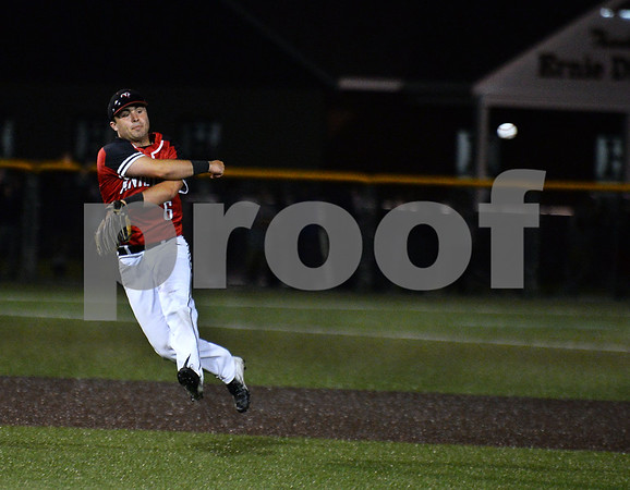 CARL RUSSO/staff photo Justin Connolly swings hard. North Andover defeated St. John's Prep in the Super 8 tourney championship game Tuesday night. 6/18/2019