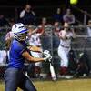 CARL RUSSO/staff photo Methuen's senior captain and first baseman, Cori Rizzo swings hard on this pitch late in the game. She hit a home run early in the game. Methuen defeated Bridgewater-Raynham 6-2 in state semifinals softball action. 6/19/2019