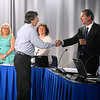 CARL RUSSO/Staff photo Salem School District Superintendent, Michael Delahanty, right, congratulates a retiring teacher who was recognized at the Salem school board meeting on Tuesday night.  5/28/2019
