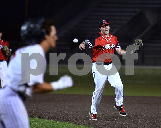 CARL RUSSO/staff photo Second baseman Jackson Berberich beats the runner with the throw to first base for the out.  North Andover defeated St. John's Prep in the Super 8 tourney championship game Tuesday night. 6/18/2019