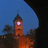 MIKE SPRINGER/Staff photo<br /> The West face of the Ayer Mill clock, shown here from underneath the Casey Bridge, is lit up in bright colors from the inside Wednesday evening during the kick-off of Illuminacion Lawrence, an initiative to light city landmarks to promote community pride and economic development.<br /> 6/5/2019