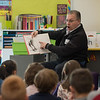 AMANDA SABGA/Staff photo<br /> <br /> City Councilor Colin LePage reads to kindergarteners at the Caleb Dustin Hunking School in Haverhill on Read Across America Day. <br /> <br /> 3/1/19
