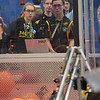 TIM JEAN/Staff photo<br /> <br /> Windham students Vivianne Snell, left, Brendan Browne and Paul Matthews guied and watch the teams robot in the qualification match during the FIRST Robotics New England District Granite State competition held at Salem High School.  3/1/19