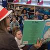 AMANDA SABGA/Staff photo<br /> <br /> Haverhill High School junior Maria Garcia Lozano reads to first graders at the Caleb Dustin Hunking School in Haverhill on Read Across America Day. <br /> <br /> 3/1/19