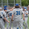 AMANDA SABGA/Staff photo<br /> <br /> Methuen High's Stephen Kenney (9) is greated by teammates and coaches with cheers after scoring during a Hillie Classic game between Methuen and Tewksbury at Trinity Stadium in Haverhill.<br /> <br /> 5/24/19