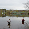 RYAN HUTTON/ Staff photo<br /> From left, Russ Cody, of Methuen, Barry George, of Windham, and Eric Roach, of Seabrook, enjoy some fishing on the West Newbury side of the Merrimack River looking toward the Rocks Village Bridge and Haverhill on Wednesday.