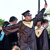CARL RUSSO/Staff photo Hector Iraheta celebrates after receiving his diploma during Haverhill high's commencement ceremony Friday evening at Trinity Stadium. Diplomas were presented to 392 graduates.  5/31/2019