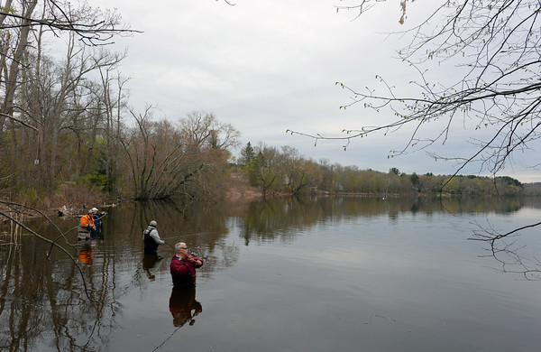 RYAN HUTTON/ Staff photo<br /> From right, Barry George, of Windham, Russ Cody, of Methuen, Kirk Brown, of Salem, and Paul Sirois, of Methuen, enjoy some fishing on the West Newbury side of the Merrimack River looking toward Haverhill on Wednesday.