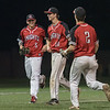AMANDA SABGA/Staff photo<br /> <br /> North Andover's Jackson Berberich, left, and Justin Connolly, right, meet teammate Sebastian Keane after he closes the game with outs during the Hillie Classic final between North Andover and Wachusett Regional at Trinity Stadium in Haverhill.<br /> <br /> 5/25/19