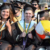 CARL RUSSO/Staff photo From left, Gillian Wojtas, Ryan Wynn and Emily  Zujewski give the thumbs up sign during Haverhill high's commencement ceremony Friday evening at Trinity Stadium. Diplomas were presented to 392 graduates.  5/31/2019