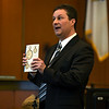 RYAN HUTTON/ THE EAGLE-TRIBUNE<br /> Prosecutor Jay Gubitose holds up a copy of Mathew Borges' journal as he delivers his closing arguments to the jury in Salem Superior Court on Monday in the murder trial of Lawrence teen Mathew Borges, who is accused of killing fellow student Lee Manuel Viloria-Paulino in 2016.