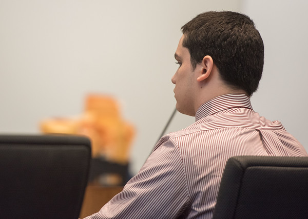 AMANDA SABGA/Staff photo<br /> <br /> Mathew Borges looks on as witnesses testify during his first-degree murder trial at Salem Superior court. Borges is accused of beheading Lee Manuel Viloria-Paulino in 2016.<br /> <br /> 5/1/19