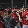 AMANDA SABGA/Staff photo<br /> <br /> North Andover teammates swarm together after defeating Wachusett Regional during the Hillie Classic final. Pitcher Brendan Holland holds the plaque as he is congratulates. <br /> <br /> 5/25/19