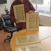 TIM JEAN/Staff photo <br /> <br /> Frank Romano, of the Museum of Printing holds several pages in frames from the Nuremberg Chronicle on display at the museum in Haverhill.      11/14/19