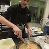 TIM JEAN/Staff photo <br /> <br /> Salem's CTE student David Edge grilles the chicken for quesadillas for the MRE Chopped Challenge, a cooking competition at Salem High School. The event was hosted by New Hampshire Department of Education and New Hampshire Army National Guard.   11/20/19