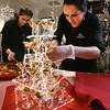 MIKE SPRINGER/Staff photo<br /> Michelle Husson of the Methuen-based Party Connection replenishes a tree-shaped display of grilled shrimp with apple chutney hors d'oeuvres during the 26th Annual Festival of Trees on Thursday in Methuen. In the background, Husson's colleague Emma Favorite prepares another specialty.<br /> 11/21/2019