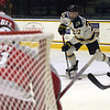 TIM JEAN/Staff photo <br /> <br /> Merrimack's Logan Drevitch looks to make a play in front of RPI's goaltender during the first period of a Mens Ice Hockey game at Merrimack College.       11/30/19
