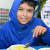 CARL RUSSO/Staff photo. Aaron Pernilla-Roche, 9 of Haverhill has a bowl of Avgolemono, Greek Chicken Soup on a cool and rainy day at Mark's Deli.  <br /> <br /> The Exchange Club of Haverhill presented their annual Food, Fun and Flare from Around the World fund raiser on Thursday, June 13. Proceeds from this springtime fundraiser benefited Haverhill's local Boys & Girls Club, YMCA, YWCA in addition to Exchange Club. <br /> <br /> The unique event stimulated taste buds with foods from across the globe: China, Greece, France, Italy, Mexico and southern United States to name a few. <br /> <br /> The 13 restaurants that participated are: G's,  Mark's Deli, Keon's 105 Bistro, Battlegrounds Coffee Co., The Lasting Room, Wang's Table, Hans Garden, La Pizza Di Forno, Olivia's, Butch's Uptown, Maria's Family Restaurant, The Peddler's Daughter and Casa Blanca. Each  restaurants featured ethnically-themed small plates from different areas of the world. 6/13/2019