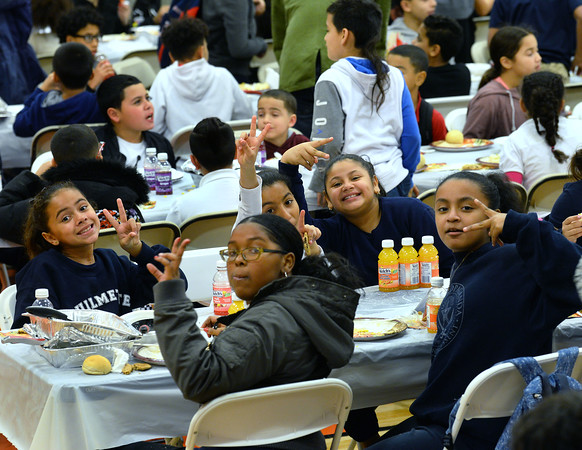 CARL RUSSO/Staff photo. The ladies are having fun at the Thanksgiving dinner. Over 400 youth members of the Boys & Girls Club of Lawrence enjoyed a traditional Thanksgiving dinner with all the trimmings Tuesday night. <br /> <br /> The dinner was donated and prepared by members of the Exchange Club of Lawrence and served by volunteers. The Exchange Club also donated a check for $2,000 to the Boys & Girls Club before the start of dinner. <br /> <br /> In addition, Executive Director Markus Fischer presented the club's 2020 Youth of the Year award to Joel Javier of Lawrence. He is a senior at the Greater Lawrence Technical high school majoring in Information Technology. <br /> <br /> Established in 1947, Youth of the Year is the Boys & Girls Club of America's premier recognition program for club members 14-18 years old who compete at the local, state, regional and national levels for college scholarships. The National Youth of the Year is installed by the President of the United States. 11/26/2019