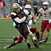 RYAN HUTTON/ Staff photo<br /> Haverhill's Aiden Alvarado tries to break a tackle during the third quarter of Thursday's Thanksgiving game at Trinity Stadium in Haverhill. Haverhill beat Lowell 28-7.