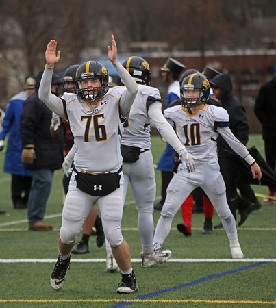 MIKE SPRINGER/Staff photo<br /> Andover's Tristan Ondek, left, signals a touchdown after quarterback Scott Brown Jr., right, carried the ball into the endzone during the Thanksgiving Day game Thursday at North Andover.<br /> 11/27/2019