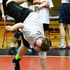 CARL RUSSO/Staff photo. Joe Gibney, a junior at Windham high celebrates with a handstand after pinning his opponent, Jake Nicolosi, a senior wrestling captain at Haverhiil high.<br />  <br /> The 6th. annual North Andover Wrestle 'Lympics was held Friday night at North Andover high school. High school varsity and middle school wrestlers competed against challenged wrestlers to benefit the Best Buddies program. 11/22/2019