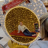 TIM JEAN/Staff photo <br /> <br /> Mia Parolisi, 10, of Haverhill sits in the selfi station as her mother Erin Parolisi snaps a photo while shopping the Black Friday deals at The Mall at Rockingham Park in Salem, NH.     11/29/19