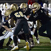 CARL RUSSO/Staff photo. Haverhill's Sam Colon-Waldron, 51, makes the initial tackle holding onto Lexington quarterback Mason Hatfield as Haverhill Hillies swarm over him. Haverhill defeated Lexington 42-28 in Friday night football action. 11/15/20199