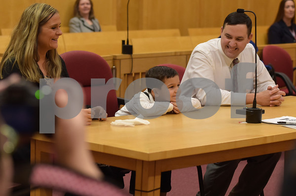 TIM JEAN/Staff photo <br /> <br /> In center, Mason Greene, 5, sits with his parents Krissy and Stephen Greene, of Braintree, listens to judge Kerry A. Ahern, Essex County Juvenile Court during a National Adoption Day ceremony held at the Fenton Judicial Center in Lawrence.     11/22/19
