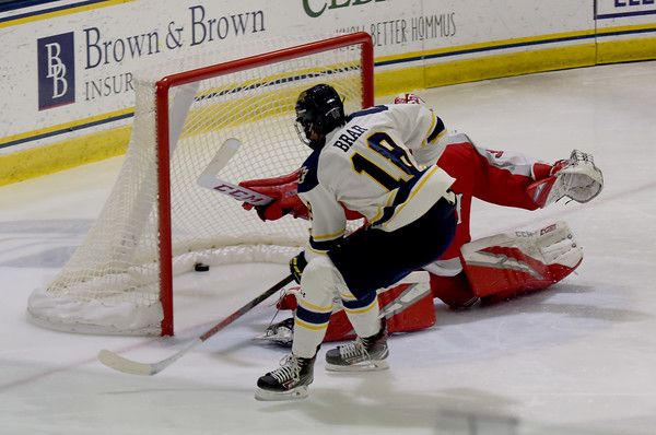 TIM JEAN/Staff photo <br /> <br /> Merrimack's Ben Brar shoots and scores against RPI goaltender Owen Savory during the first period of a Mens Ice Hockey game at Merrimack College.       11/30/19