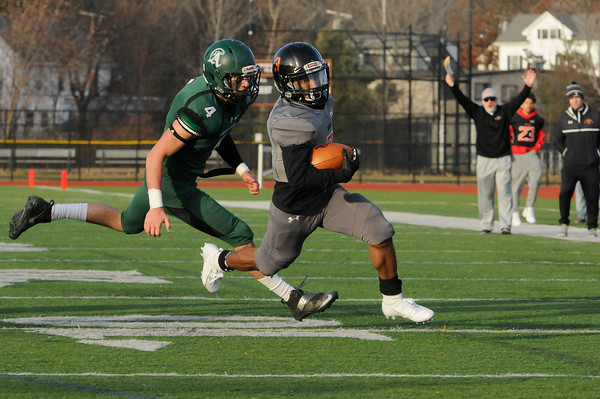 TIM JEAN/Staff photo <br /> <br /> Greater Lawrence's Anthony Alves breaks a tackle and gets away from Abington's Will Klein and scores a touchdown during the Division 7 semifinal football game in Woburn. Greater Lawrence lost 33-22.  11/23/19