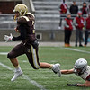 RYAN HUTTON/ Staff photo<br /> Haverhill quarterback Brady Skafas runs the ball in for a touchdown during the first quarter of Thursday's Thanksgiving game at Trinity Stadium in Haverhill. Haverhill beat Lowell 28-7.
