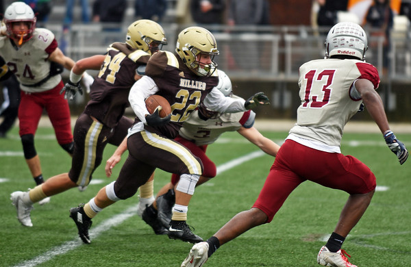 RYAN HUTTON/ Staff photo<br /> Haverhill's Aiden Alvarado dashes downfield to score a touchdown during the second quarter of Thursday's Thanksgiving game at Trinity Stadium in Haverhill. Haverhill beat Lowell 28-7.