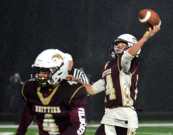 CARL RUSSO/Staff photo. Whittier's quarterback Niko Burke throws one of only a few passes during the game for a completion. Whittier Wildcats defeated the Greater Lawrence Reggies in Thanksgiving Eve football action. 11/27/2019