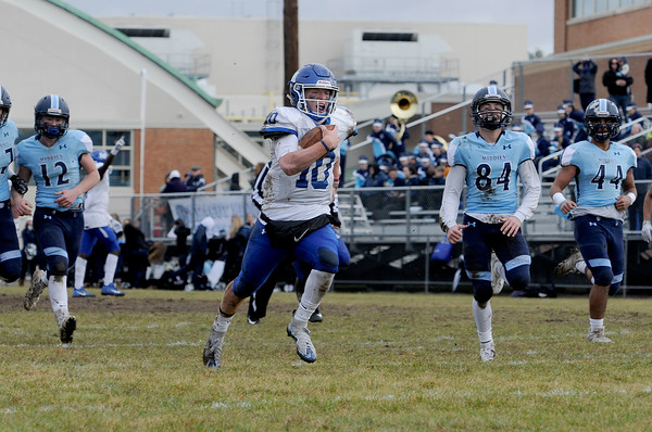 TIM JEAN/Staff photo <br /> <br /> Methuen's Connor Bryant splits the Dracut defense and runs for a touchdown during the annual Thanksgiving day football game at Dracut High School. Methuen won 50-40.  11/28/19