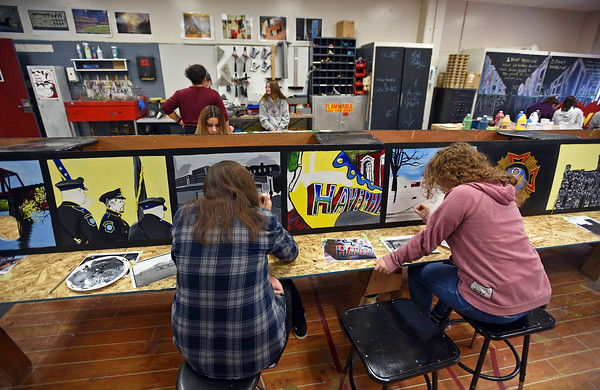 """RYAN HUTTON/ Staff photo<br /> Katelyn Caruso, 16, left, and Olivia Dekofski, 16, right, paint a pair of side panels for Whittier Tech's parade float in preparation for Sunday's VFW Santa Parade in Haverhill. This year's theme is """"heroes""""."""