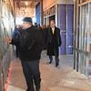 TIM JEAN/Staff photo <br /> <br /> Denis Boucher, left, the new NECC Culinary Arts and Hospitality Program Manager, leads a group with NECC President Lane Glenn, right, during a walk though of the construction site of the new Haverhill Heights building being built in downtown Haverhill.  11/13/19