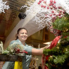 """TIM JEAN/Staff photo <br /> <br /> Ashley Hashem, of Methuen, decorates her themed tree """"Christmas Spirit"""" as she participants in the annual Festival of Trees in Methuen.         11/15/19"""