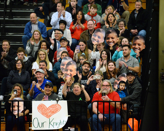 CARL RUSSO/Staff photo. Family members of wrestler Aayden Twohig cheer for him and wave photos of him. <br /> <br /> The 6th. annual North Andover Wrestle 'Lympics was held Friday night at North Andover high school. High school varsity and middle school wrestlers competed against challenged wrestlers to benefit the Best Buddies program. 11/22/2019