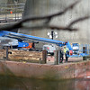 RYAN HUTTON/ Staff photo<br /> Police inspect a lift on a barge in the Merrimack River under the I-495 bridge on Wednesday morning. At least one construction worker was killed an another flown to a Boston hospital after a fall onto a barge according to the Essex County District Attorney's Office.