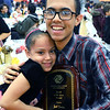CARL RUSSO/Staff photo. The 2020 Boys & Girls Club of Lawrence Youth of the Year award recipient, Joel Javier of Lawrence is congratulate by his sister, Katherine, 8. He is a senior at the Greater Lawrence Technical high school majoring in Information Technology. <br />  <br /> Over 400 youth members of the Boys & Girls Club of Lawrence enjoyed a traditional Thanksgiving dinner with all the trimmings  Tuesday night. The dinner was donated and prepared by members of the Exchange Club of Lawrence and served by volunteers. The Exchange Club also donated a check for $2,000 to the Boys & Girls Club before the start of dinner. <br /> <br /> In addition, Executive Director Markus Fischer presented the club's 2020 Youth of the Year award to Joel Javier of Lawrence. He is a senior at the Greater Lawrence Technical high school majoring in Information Technology. <br /> <br /> Established in 1947, Youth of the Year is the Boys & Girls Club of America's premier recognition program for club members 14-18 years old who compete at the local, state, regional and national levels for college scholarships. The National Youth of the Year is installed by the President of the United States. 11/26/2019