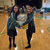 RYAN HUTTON/ Staff photo<br /> Sophie Roscigno, 12, left, and Jiya Amin, 12, right, carry a donation box full of Thanksgiving groceries out of the St. Joseph Regional Catholic School cafetorium to load into food bank vans on Monday.