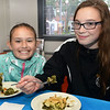 CARL RUSSO/Staff photo. Alexis Pernilla-Roche, 9 and Victoria Dawkins, 14, both of Haverhill try the spinokopti, Greek spinach at Mark's Deli. <br /> <br /> The Exchange Club of Haverhill presented their annual Food, Fun and Flare from Around the World fund raiser on Thursday, June 13. Proceeds from this springtime fundraiser benefited Haverhill's local Boys & Girls Club, YMCA, YWCA in addition to Exchange Club. <br /> <br /> The unique event stimulated taste buds with foods from across the globe: China, Greece, France, Italy, Mexico and southern United States to name a few. <br /> <br /> The 13 restaurants that participated are: G's,  Mark's Deli, Keon's 105 Bistro, Battlegrounds Coffee Co., The Lasting Room, Wang's Table, Hans Garden, La Pizza Di Forno, Olivia's, Butch's Uptown, Maria's Family Restaurant, The Peddler's Daughter and Casa Blanca. Each  restaurants featured ethnically-themed small plates from different areas of the world. 6/13/2019