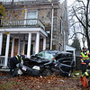 CARL RUSSO/Staff photo. A car hit an Andover house at 374 Williams Street near the intersection of Williams and (Rt. 28) North Main Street late Tuesday afternoon. The driver of the vehicle was taken to the hospital. Elm Street Towing removed the car from the property. 11/19/2019