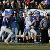 TIM JEAN/Staff photo <br /> <br /> Salem's Kaleb Bates breaks tackles and runs for a big gain against Londonderry during the New Hampshire Division 1 semifinal football game. Salem lost 35-14.     11/16/19