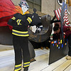 """RYAN HUTTON/ Staff photo<br /> Keily Martinez, 16, paints Whittier Tech's parade float in preparation for Sunday's VFW Santa Parade in Haverhill. This year's theme is """"heroes""""."""